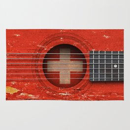 Old Vintage Acoustic Guitar with Swiss Flag Rug