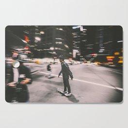 Skate in street 4 Cutting Board
