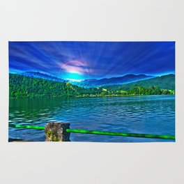Sun over Lake Schliersee bavaria Germany Rug
