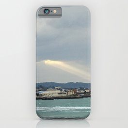 The sunlight shining through the clouds over the jeju sea village , Jeju Island, Korea. iPhone Case