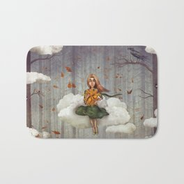 The little  girl sits on a cloud  in   autumn forest Bath Mat