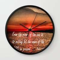 scripture Wall Clocks featuring Bible Scripture Psalm 113:3 by Saribelle Inspirational Art