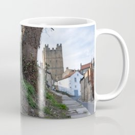 A view of daffodils in the foreground and Richmond Castle, North Yorkshire in the background Coffee Mug