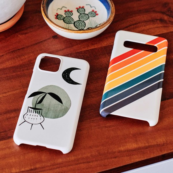 abstract phone cases on a wooden desk