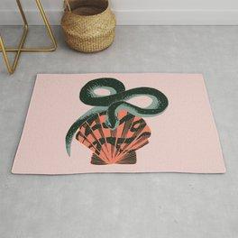 Black coral snake on pink background Rug