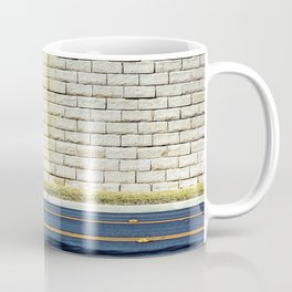 road with shadows and brick wall background Coffee Mug