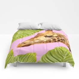 Giraffe with green leaves on a pink background Comforters