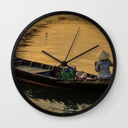 Boat on the River at Sunset Wall Clock