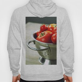 fresh tomatoes (in metal colander) and herbs on a wooden table Hoody