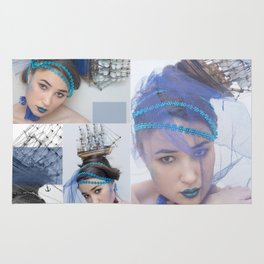 sea queen. face of the young beautiful girl make-up in sea style Rug