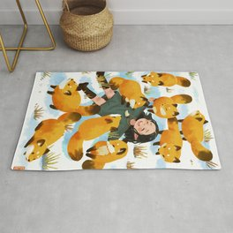 Snuggles with foxes Rug