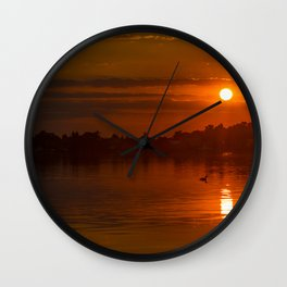 Red sky over the water Wall Clock
