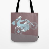 die hard Tote Bags featuring hard by The Junkers