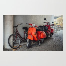 Red scooters in Berlin Rug