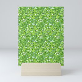 Funny green frogs entangled in a messy pattern Mini Art Print