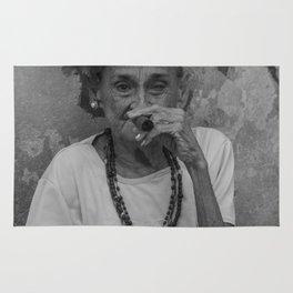 Old lady smoking cuban cigar in Havana Rug