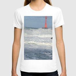 The waves of Jeju sea crashing on the breakwater of the lighthouse , Jeju Island, Korea. T-shirt