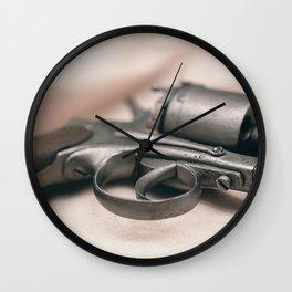 Ancient revolver. Old gun. Wall Clock