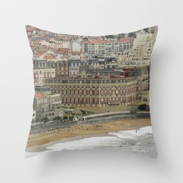 Beach landscape France: The ancient seaside resort architecture of Biarritz with its Belle Époque ritzy charme and glamourous vibe along the Grand Plage at stormy weather Throw Pillow