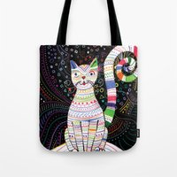 space cat Tote Bags featuring Space cat by ezgi karaata