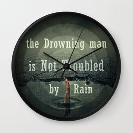the drawning man is not troubled by rain Wall Clock
