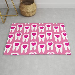 Teeth pattern with hearts in the center on pink background Rug