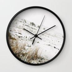 Heavy snow falling on a mountainside. Cumbria, UK. Wall Clock