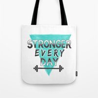 crossfit Tote Bags featuring Stronger Every Day (barbell) by Lionheart Art