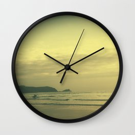 Tilt and shift sun down surfer, Fistral Beach, Newquay, Cornwall Wall Clock
