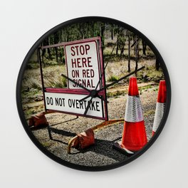 Stop on the red light - roadworks sign. Wall Clock