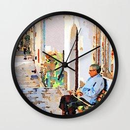 Borrello: senior citizen sitting on a bench outside the home Wall Clock