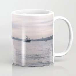 A beautiful girl enjoying Istanbul city view from the sea at sunset Coffee Mug