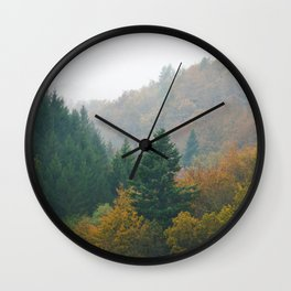 Foggy autumn forest layers disappearing in fog Wall Clock