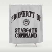stargate Shower Curtains featuring Property of Stargate Command Athletic Wear Black ink by RockatemanDesigns