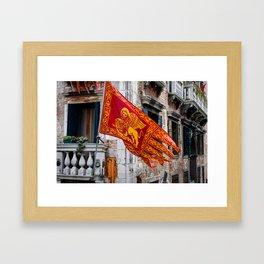 Colors of Venezia, golden-red flag, old building at background Framed Art Print