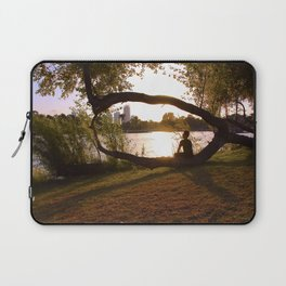 Beautiful nature, guy sitting on a curved tree on sunset Laptop Sleeve