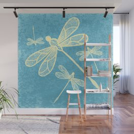 Abstract dragonflies in yellow on textured blue Wall Mural