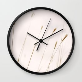 Tall grass against cloudy sky Wall Clock