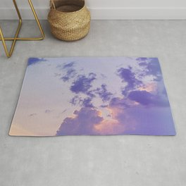 Sun behind the clouds Rug