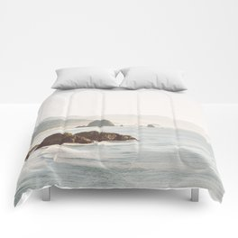 overlooking cannon beach Comforters