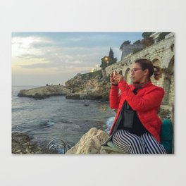 Woman taking a picture in a beach in the Rovinj city center Canvas Print