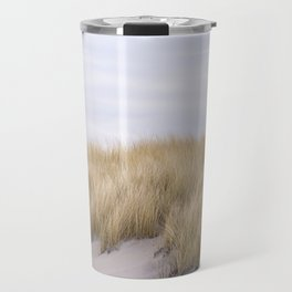 Field of grass growing in the sand Travel Mug