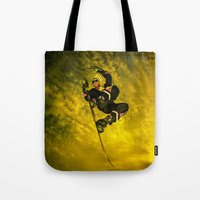snowboarding Tote Bags featuring Snowboarding #1  by Bruce Stanfield