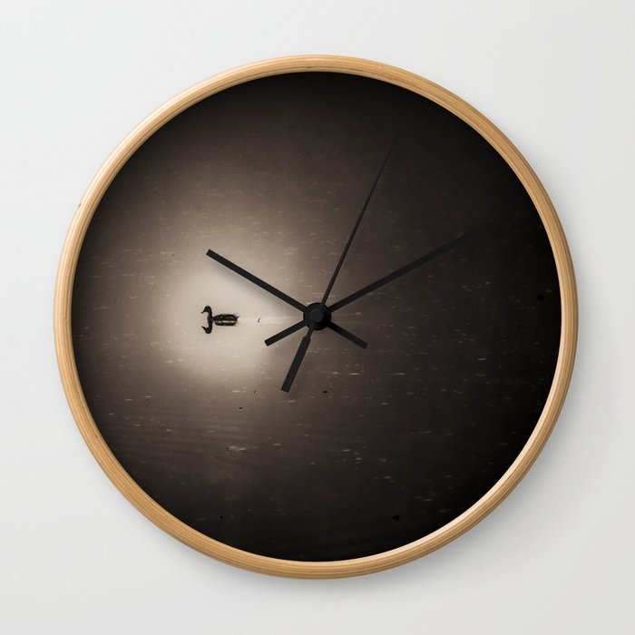 Lone duck on a quiet lake Wall Clock