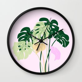 monstera plant on pink background Wall Clock