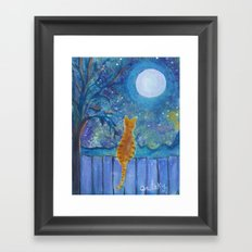 Cat on a fence in the moonlight Framed Art Print