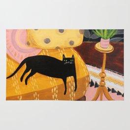 black cat on mustard yellow sofa painting by Tascha Rug
