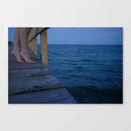 Woman standing on the edge of a pier Canvas Print