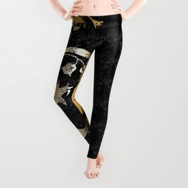 Abstract floral ornament in black and gold colors Leggings