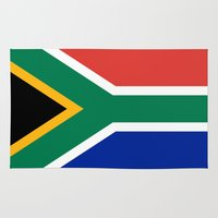 south africa Area & Throw Rugs featuring Flag of South Africa by Neville Hawkins